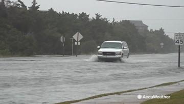 Powerful surf inundates highway