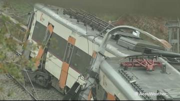 Landslide derails commuter train, killing 1
