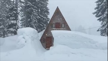 Cabin left buried under incredible amount of snow