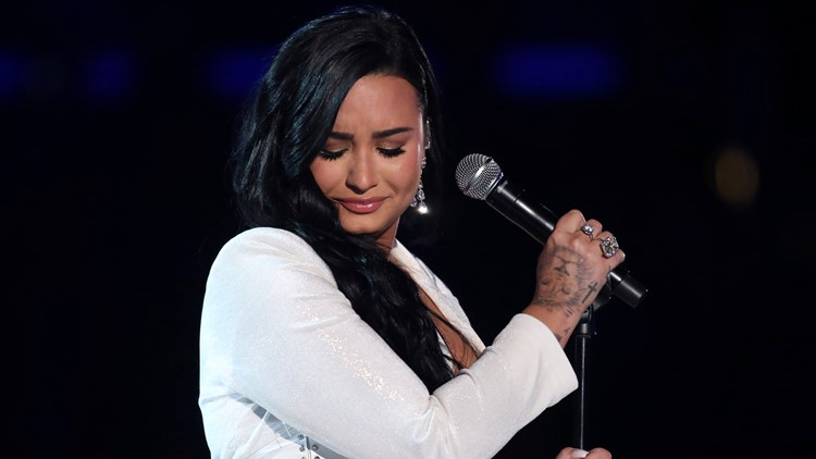Demi Lovato restarts song at Grammys, delivers powerful performance