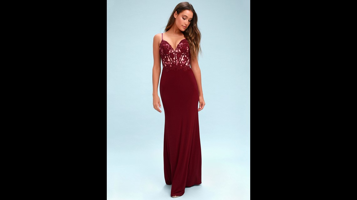 ede53850bb This burgundy embroidered gown also features lace and rhinestones on its  bodice