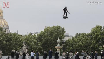French Inventor Flies Above Crowd On Hoverboard During Bastille Day Celebration !