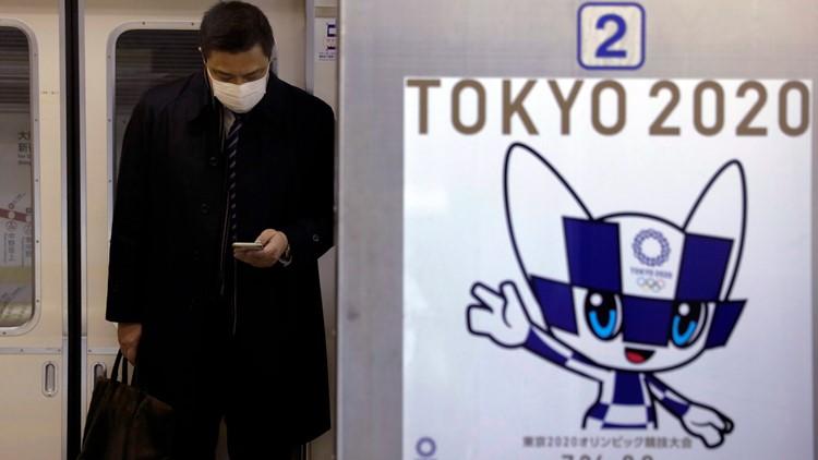 APTOPIX Japan China Outbreak