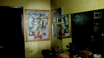 Stolen painting worth $165M found behind bedroom door
