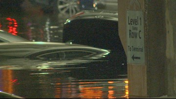 Flooding leaves vehicles underwater at Dallas Love Field parking garage