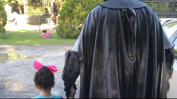 Batman walks toddler to school after she was bullied