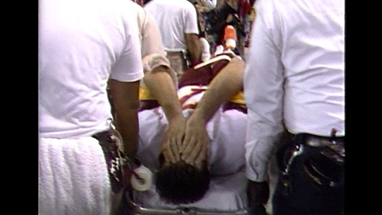 Joe Theismann being carried out on a stretcher