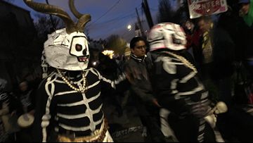 Skeletons walk the streets of New Orleans, waking the city for Mardi Gras