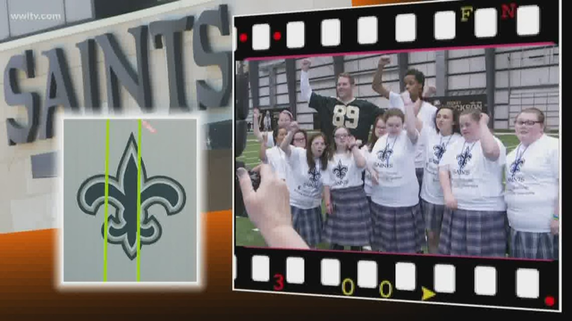 Saints players practice with St. Michael Special School students