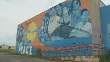 'The Peace Wall' mural will be torn down with Grand Theater after fire