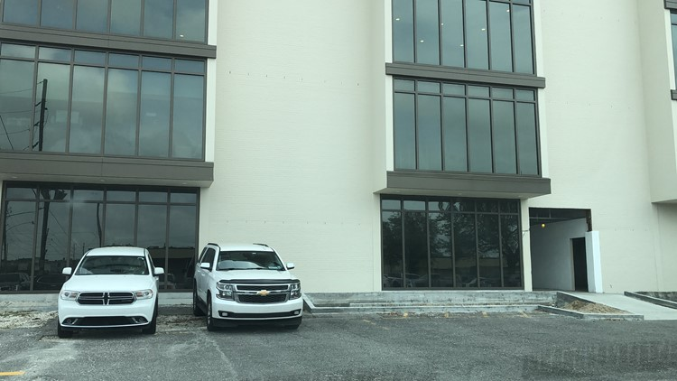 State Police vehicle outside Buisson's office