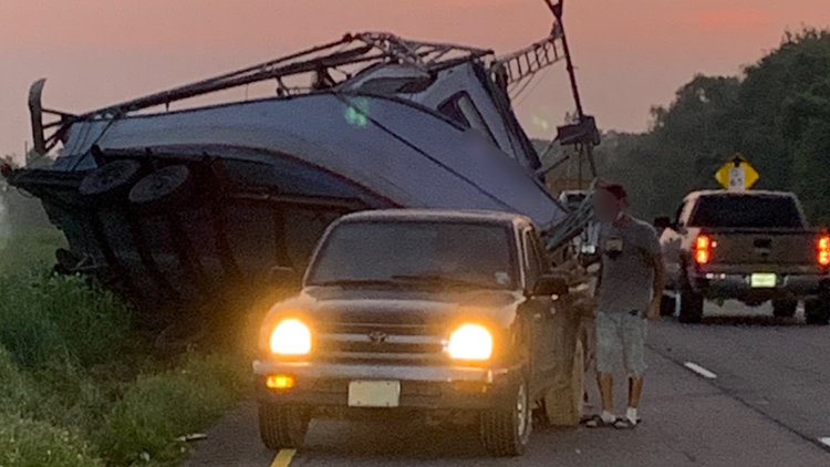 Shrimp boat in-tow overturns, snags truck, catches traffic in Lafourche