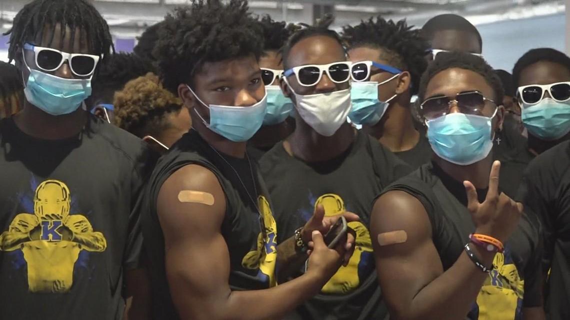 JFK high football players get vaccinated