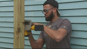 Saints join volunteers to renovate St. Roch home