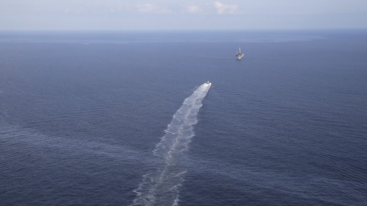 Containment efforts begin for 15-year Gulf oil leak