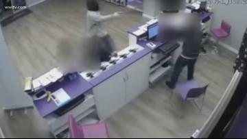 Masked man robs store at gunpoint as children shop inside