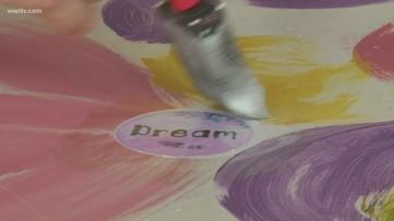 Jefferson Parish artists turns salvaged school desks into works of art for students