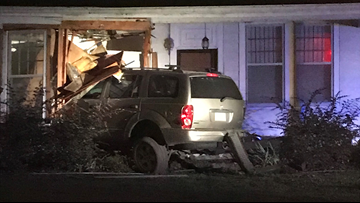 Woman arrested after SUV slams into River Ridge home