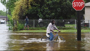 Weakened Barry still poses flood, tornado risks