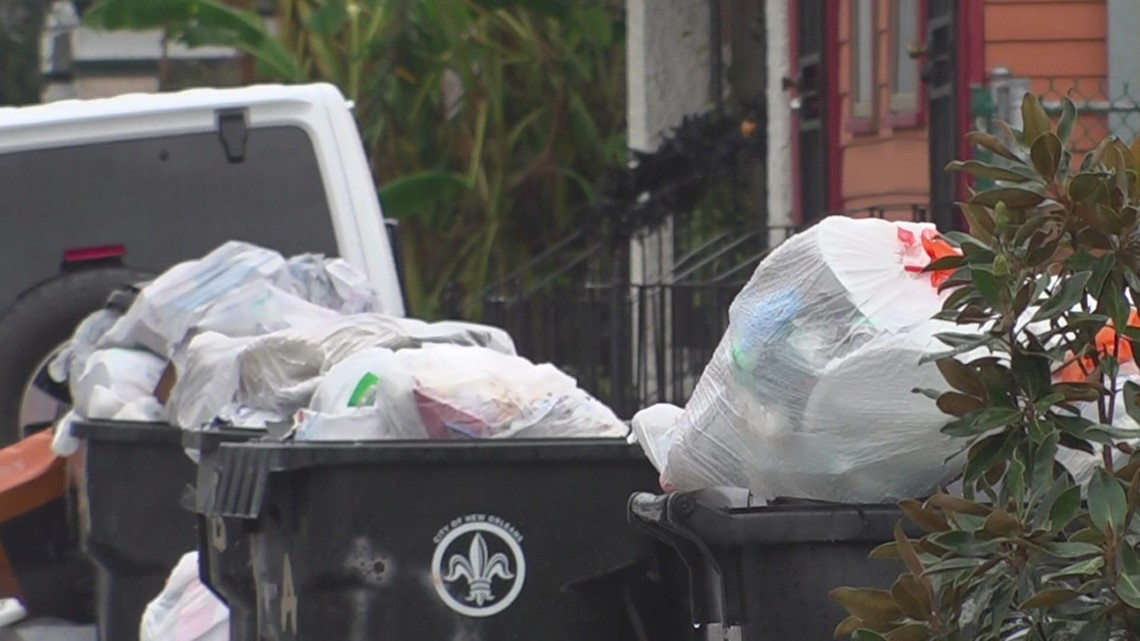 New Orleanians march to City Hall with trash in hand, on the curb, in the streets