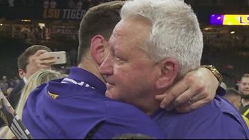 Steve Ensminger embraces son after National Championship win