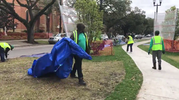 City crews trash ladders, tarps and chairs left along parade route