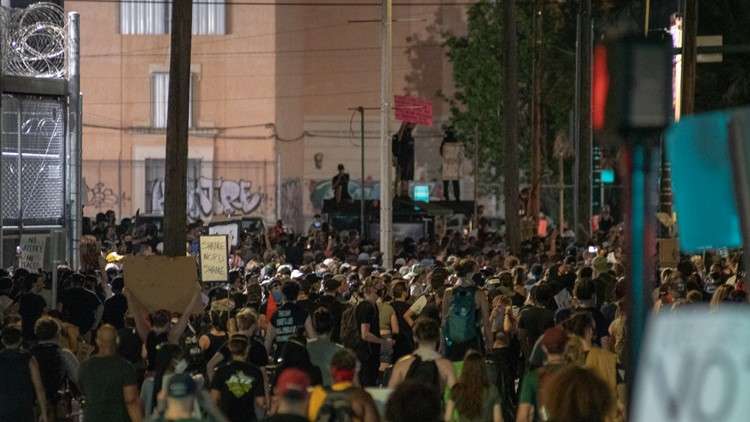 PHOTOS: Thousands march peacefully on NOPD headquarters following tear gas incident