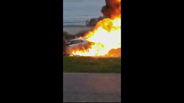 Good Samaritans pull woman from burning car