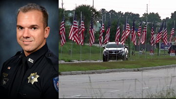 Nearly 200 flags placed ahead of funeral for deputy killed in crash