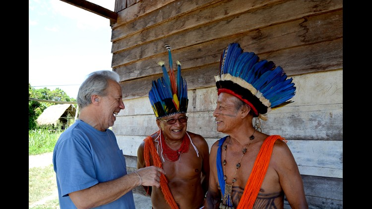 Mark Plotkin laughing with natives of the Amazon rainforest