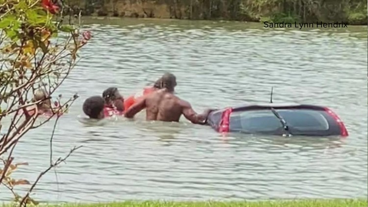Woman rescued by strangers after driving into pond on the Northshore