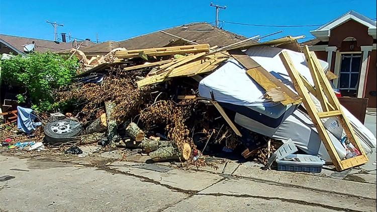 Storm debris and garbage pile up on roadsides in LaPlace