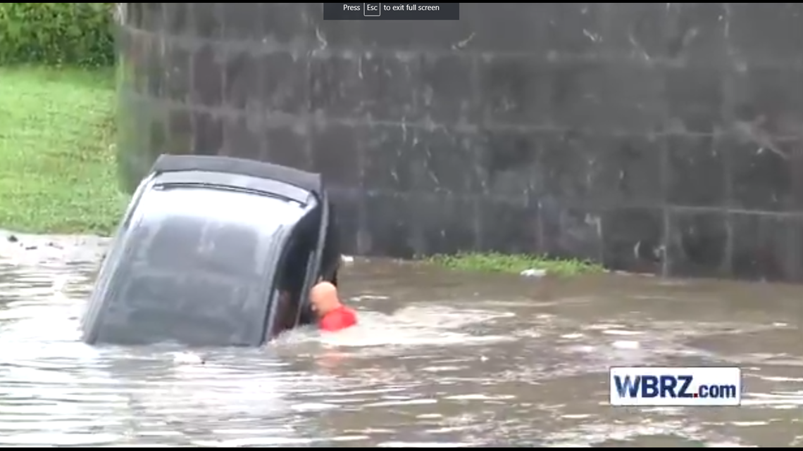 VIDEO: Woman rescued from sinking car in Baton Rouge floodwaters