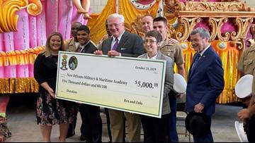 Rex and Zulu members donate $10,000 to local schools