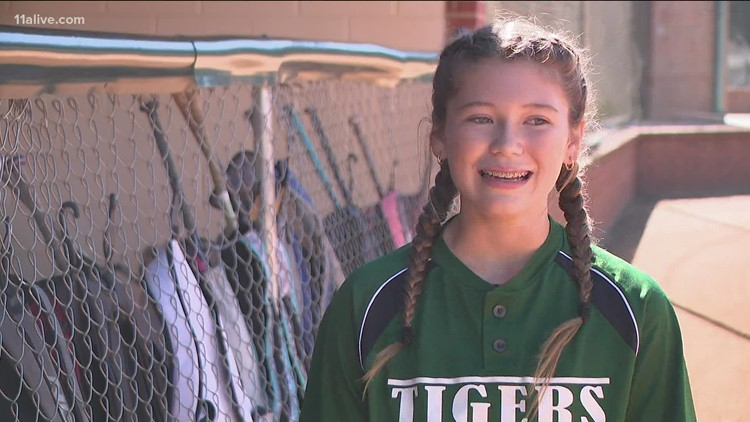8th grade softball player pitches for opposing team when their player gets sick